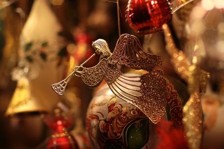 glitzy: Closeup view of one beautiful christmas or new year fir tree decoration of angel toy on blurred background, horizontal picture Stock Photo