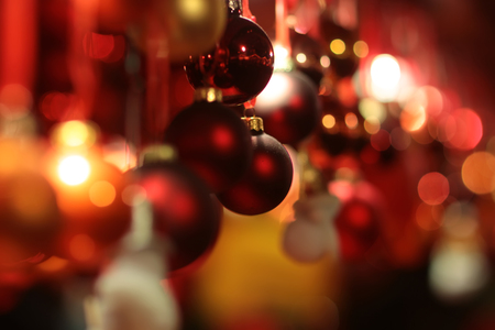 glitzy: Picture of shiny and blurred red Christmas garland made from baubles of different sizes texture and shades, horizontal picture