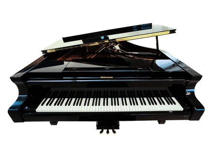 Closeup view of one beautiful big shiny black open piano forte with white key board standing in studio isolated on white background, horizontal picture Stock Photo