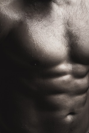 pectoral muscle: Closeup view of one handsome sexual strong young male bare chest of muscular wet body standing posing on studio background black and white, vertical picture
