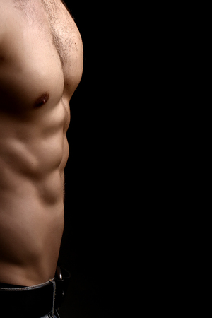 nackte brust: Closeup view of one handsome sexual strong young male bare chest of muscular body standing posing on studio background, vertical picture