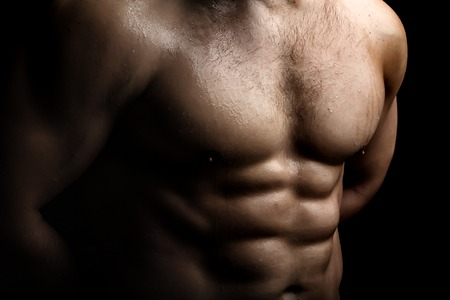 nackte brust: Closeup view of one handsome sexual strong young male bare chest of muscular wet body standing posing on studio background, horizontal picture