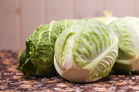 minerals food: Heads of ripe delicious white and chinese cabbage vegetable with green leaves and lot of minerals organic food studio on blur background, horizontal picture