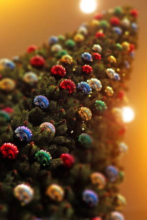 happy holidays: Closeup view of one big high beautiful fresh decorated new year fir green tree with many colorful christmas balls, vertical picture Stock Photo