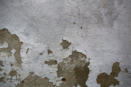 damaged cement: Photo closeup of shabby damaged cement gray wall with peeled old chipped flaked plaster cover outdoor on concrete mural background, horizontal picture Stock Photo