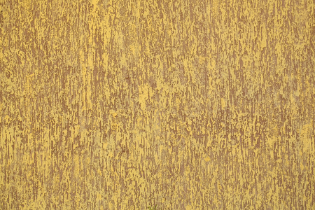 stucco facade: Photo closeup of warm plastered brown yellow painted colored wall rough textured decorative stucco facade interior on background, horizontal picture Stock Photo