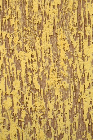 stucco facade: Photo closeup of warm plastered brown yellow painted colored wall rough textured decorative stucco facade interior on background, vertical picture Stock Photo