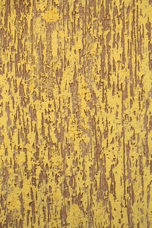 Photo closeup of warm plastered brown yellow painted colored wall rough textured decorative stucco facade interior on background, vertical picture Stock Photo