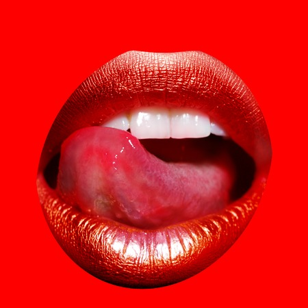 Closeup view of sexual beautiful female open golden lips with licking tongue and white teeth isolated on red background, square picture