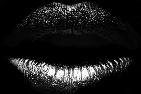 Closeup view of sexual beautiful female open closed lips isolated on studio background black and white, horizontal picture 免版税图像