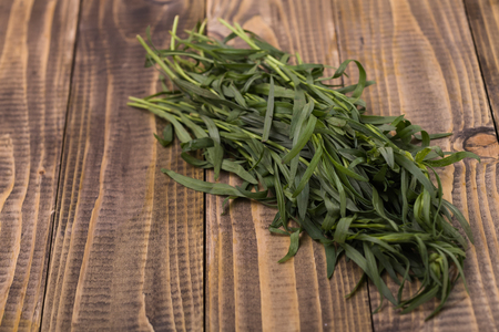 potherb: Fresh aromatic twigs of eating pot-herb herbal organic ingredients seasoning cooking healthy lifestyle on wooden background closeup studio, horisontal picture Stock Photo