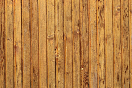 boarded: Photo closeup of new unpainted close boarded fence wooden palisade wood boards with knots on timber background, horizontal picture
