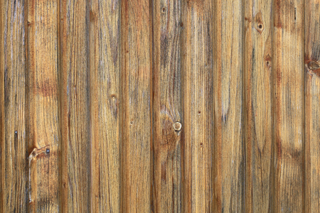 boarded: Photo closeup of blind unpainted close boarded fence wooden palisade wood boards with knots on timber background, horizontal picture Stock Photo