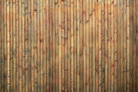Photo closeup of blind unpainted close boarded fence wooden palisade of strip wood boards with knots on timber background, horizontal picture Reklamní fotografie