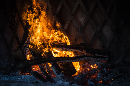 cinders: Photo closeup of fire lit burning flashing wood kindled orange tongues of flame live embers coal cinders on fireplace background, horizontal picture Stock Photo