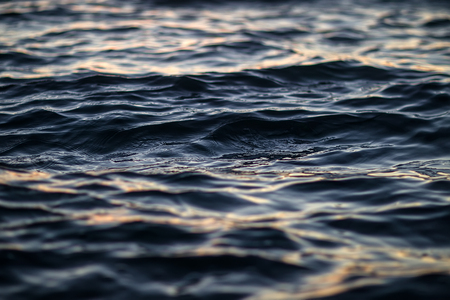 ocean waves: Photo closeup of beautiful clear dark blue sea ocean water surface with ripples low waves on seascape background, horizontal picture