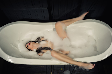 Sexy woman in bath tab
