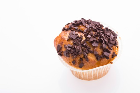 paper basket: Tasty homemade dessert muffin cake with top decorated by chocolate crumb in paper basket holiday menu delisious sweet meal isolated on white background, horizontal picture