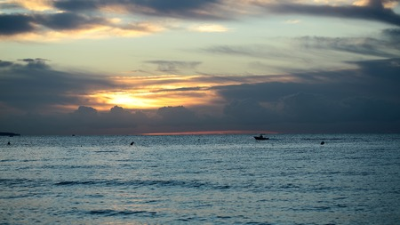 desolaci�n: Photo of spectacular marine seashore blue sea with ripples against orange low level cloudy sky at sunset time dusk bleakness over seascape background, horizontal picture Foto de archivo