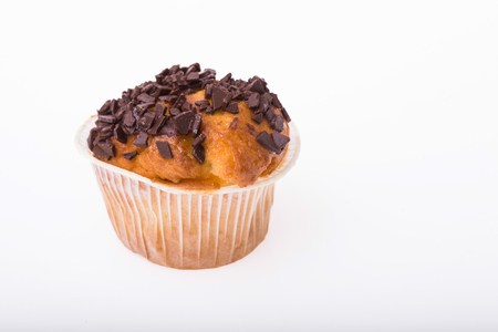 fattening: One appetizing traditional american muffin with chocolate chips homemade dessert for holiday party carbohydrates fattening bakery with many calories isolated on white background, horizontal picture