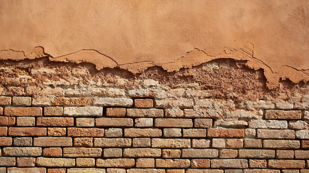 clay brick: Photo closeup outdoor aged terracotta clay brick and decorative stucco facade wall exterior building materials for masonry construction on mural background, horizontal picture