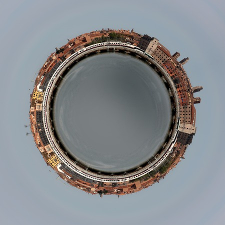 edited photo: Photo of old town different buildings streetscape and sea water in form of sphere in centre composited edited manipulated in Photoshop on grey background, square picture