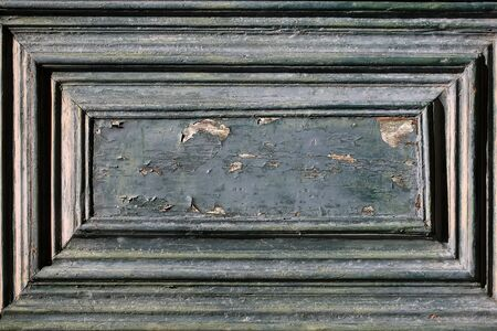 loosing: Photo closeup of component of aged wooden door panel loosing grey paint peeled on timber background, horizontal picture Stock Photo