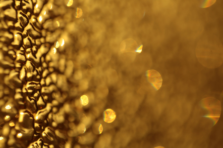 glisten: Sparkling glorious glossy beautiful glisten bright yellow glass backdrop with blur effect decorative opaque material, horizontal picture Stock Photo