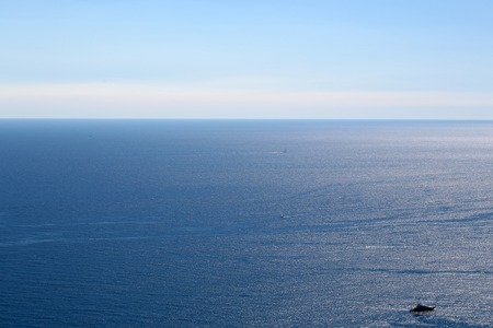 blue vessels: Photo seen from above of peaceful offing and vessels offshore zone seacoast coastal waters of beautiful blue sea horizon on wonderful weather day time on clear sky background, horizontal picture