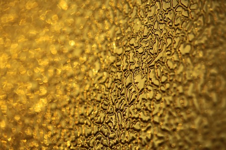 splendid: Splendid glorious colorful yellow texture glass material glittery backdrop relief structure space abstract glossy wallpaper copyspace closeup, horizontal picture