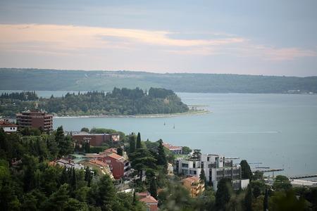 splendid: Campania. Italy - Month 09.2015: Splendid seaside of italian modern luxurious resort with buildings opposite of beautiful island with green vivid foliage in mediterranean sea outdoor, horizontal
