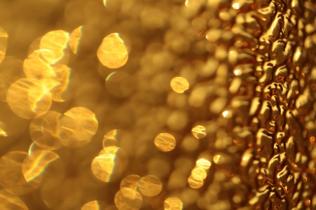 prominence: Pretty pattern yellow glossy beautiful soft glisten backdrop bight art decorative space sparkling abstract shiny textured surface , horizontal picture Stock Photo