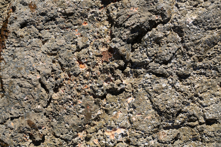 costal: Photo closeup of costal beach sharp salty terracotta gray rock stone formations minerals solid layer on natural background, horizontal picture Stock Photo