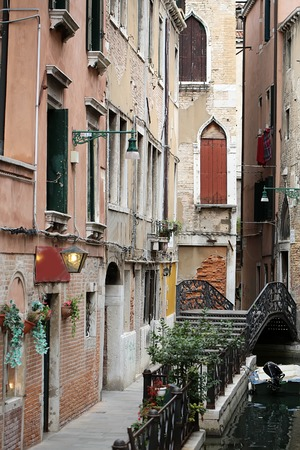 splendid: VENICE, ITALY - SEPTEMBER 22: Picturesque urban scenery of authentic italian old beautiful narrow street with vintage splendid medieval architecture brick buildings outdoor, vertical picture