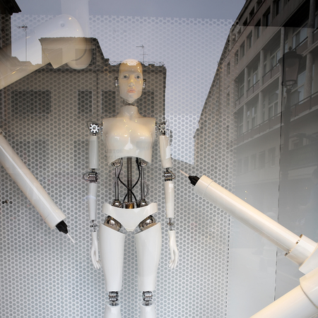 townscape: Venice, Italy - September 22, 2015: one robot stands in shop window venetian architecture reflects in show glass on townscape background, square picture Editorial