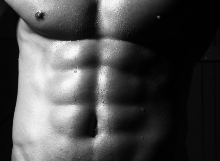 nude abs: Closeup of sensual bare torso with abs pectorals and 6 pack muscles Stock Photo
