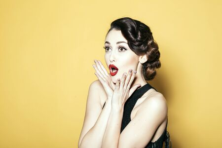 adult sexual: Glamour retro elegant young adult surprised woman with classic hairstyle and red lips Stock Photo