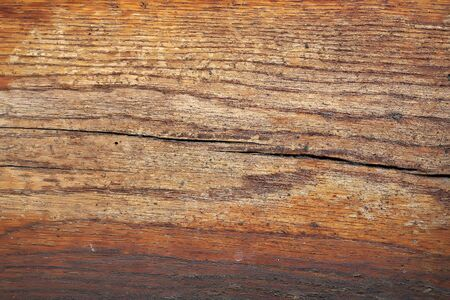 fibrous: Board wooden cracked old aged faded brown paint horizontal plank with porous and fibrous structure closeup on timber background
