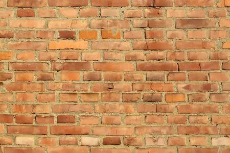 red clay: Brick red clay rectangular facade wall exterior building materials closeup on masonry background