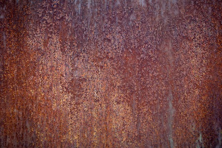 gradual: Rusty iron surface old red grunge sheet of iron fragment of protective structure made of metal plate  closeup on armor textured background