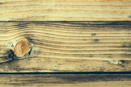 fibrous: Wood knot in horizontal section on porous and fibrous structural wooden plank unpainted closeup on timber background Stock Photo