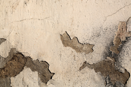 damaged cement: Cement grey wall shabby damaged with peeled old chipped flaked plaster cover outdoor on concrete mural background Stock Photo