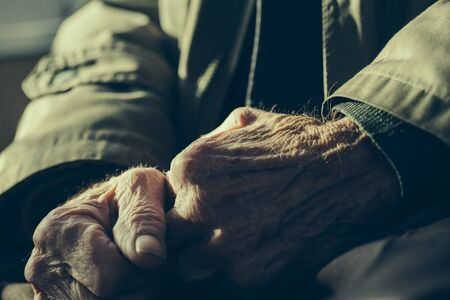 shrunken: Hands of the old man. Lots of texture and character in the old male hands. Stock Photo
