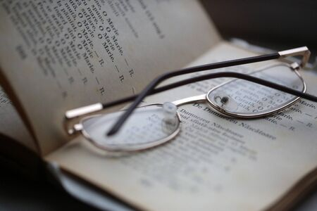 poems: Closeup of reading glasses on the book with poems.