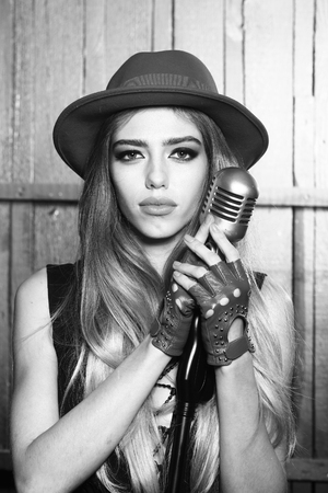 sexi: Beauty and fashion, music. Pretty woman with retro microphone., black and white