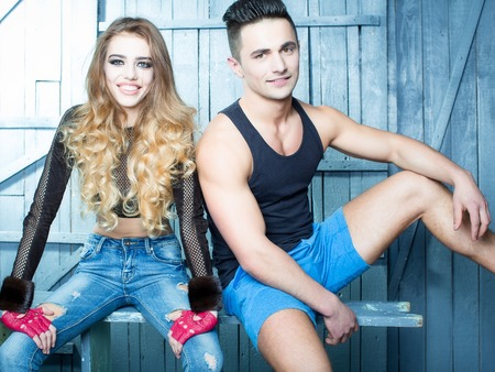 sexual relations: Stylish couple. Shot of a fashionable couple posing at studio Stock Photo