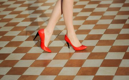 red heels: Beautiful female legs with sexy red heels Stock Photo