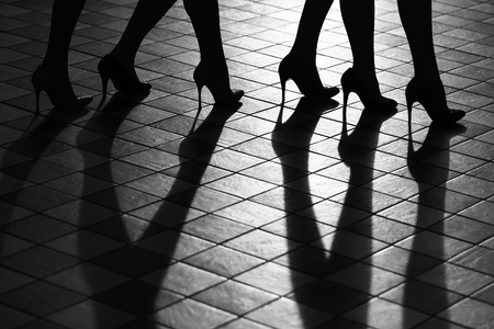 sexy woman silhouette: Beauty and fashion, body parts. Female legs in fashionable shoes silhouette, black and white Stock Photo