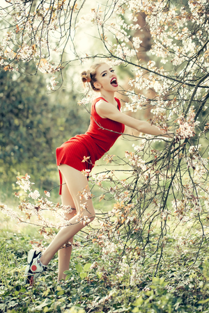 spring training: Beautiful happy young woman training and enjoying beauty in a flowering spring garden