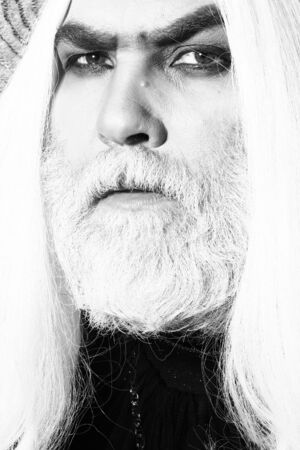 periwig: Bearded senior man in long white wig with serious face, black and white